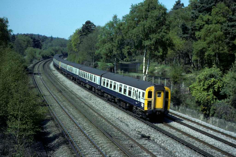 3015 etc, Brookwood, Sat 10 May 1980.  The 4-REP / class 430 EMU leads two 4-TC / class 491 trailer sets on the 0925 Bournemouth - Waterloo.  Photo by Les Tindall.