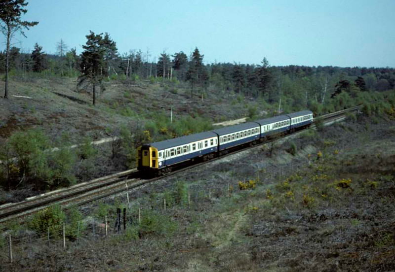 7717, near Brookwood, Sat 10 May 1980.  A 4-VEP / class 430 EMU on the Alton branvch with the 1042 from Waterloo.  Photo by Les Tindall.
