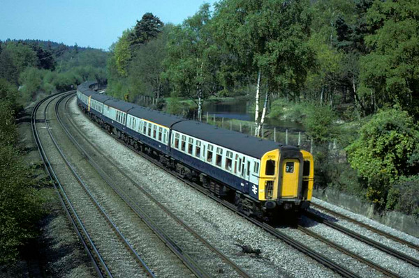 3003 etc, Brookwood, Sat 10 May 1980.  The 4-REP / class 430 EMU leads two 4-TC / class 491 trailer sets on the 0902 Bournemouth - Waterloo.  Photo by Les Tindall.