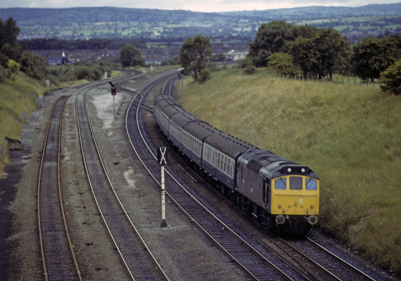 25090, Saltney Junction, Sat 28 July 1979.  The 1130 Bangor - Manchester Victoria.  NB that the former GWR line to Wrexham is being singled.  The former D5240 was withdrawn in 1983.  Photo by Les Tindall.