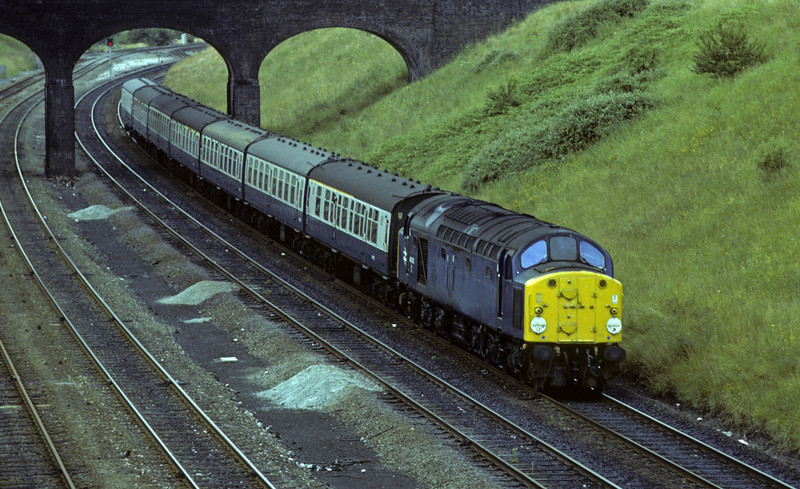 40013, approaching Chester, Sat 28 July 1979.  The 0919 Holyhead - Crewe.  Saltney Junction can be seen in the distance.  In 2012 the former D213 Andania was in preservation at Barrow Hill.  Photo by Les Tindall.