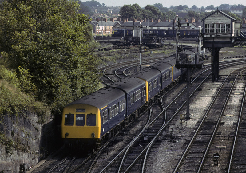 A Llandudno - Manchester train fomed of four two-car DMUs heads away from the camera past Chester No 6 signal box, Sat 28 July 1979.  NB the oil lamp.  Photo by Les Tindall.