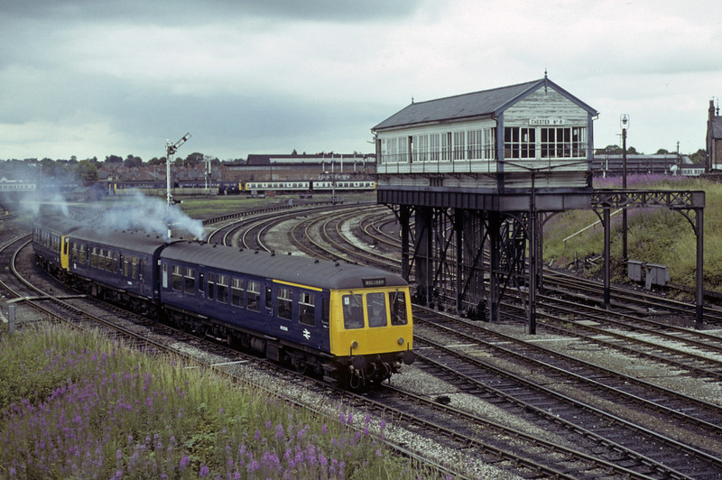 M51566 etc, passing Chester No 6 box, Sat 28 July 1979.  The DMUs seen earlier get the road, led by a class 108.  Photo by Les Tindall.