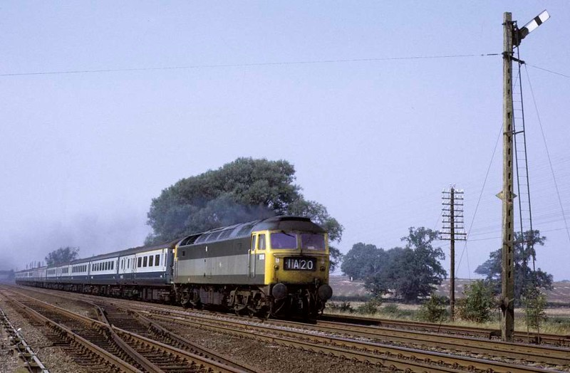 1110 (47527), 1A20, near Essendine, Sat 8 September 1973.  The 1110 Leeds - King's Cross passes a soon to be replaced semaphore.  Photo by Les Tindall.
