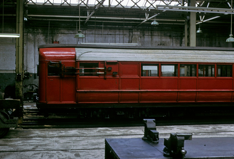 Broomloan Road workshops, Glasgow Underground, 11 May 1974 5.     On the side of the carriage is the horn and the current collector for its lighting.  (The doors were on the other side.) Photo by Les Tindall.