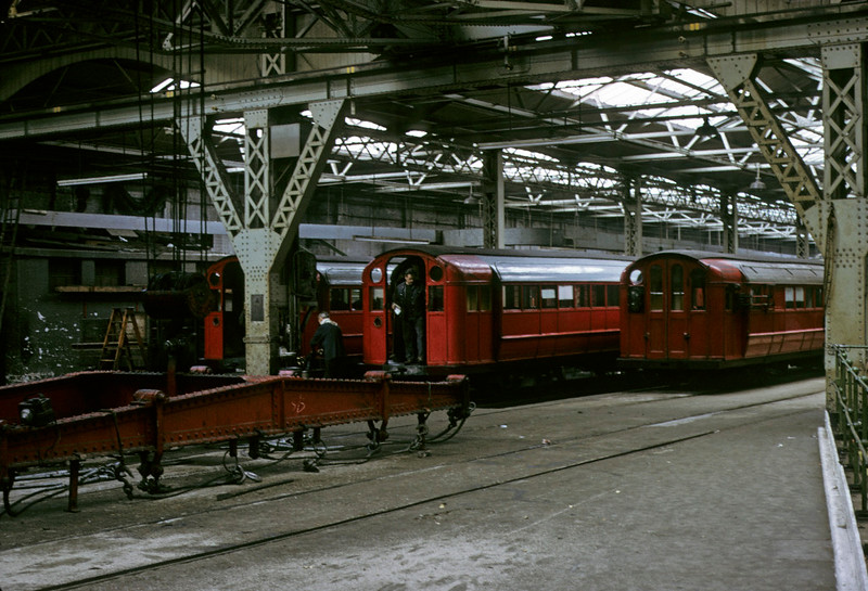 Broomloan Road workshops, Glasgow Underground, 11 May 1974 2.    At left is the crane used to lift carriages from the tunnel.  (As the skylights show, the workshop was on the surface.)  Photo by Les Tindall.