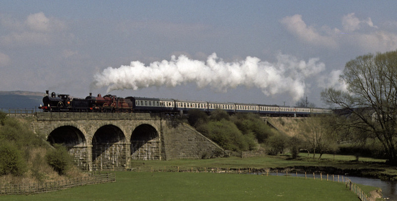 LNWR 2-4-0 790 Hardwicke & Midland 4-4-0 1000, leaving Gargrave, Sat 24 April 1976    (Extra coaches had been added at Leeds.) Photo by Les Tindall.