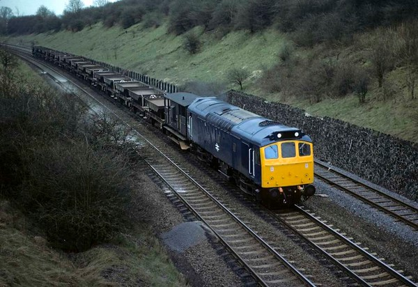 25214, Kibworth, 17 April 1979.  Heading north with a ballast train.  The former D7564 was withdrawn in November 1982.  Photo by Les Tindall.