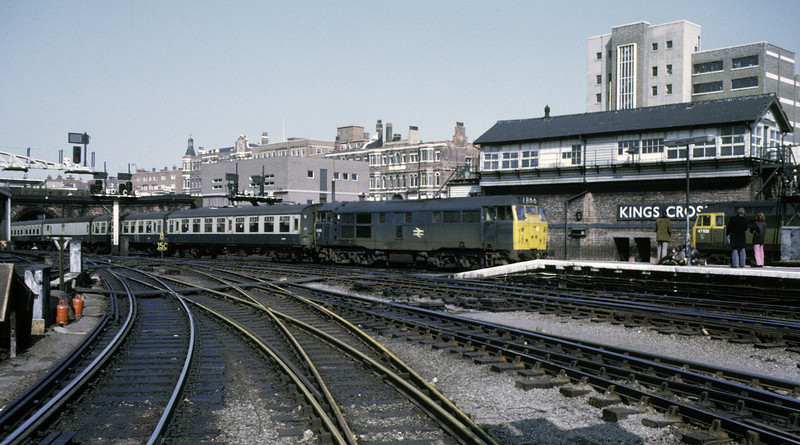 31202, King's Cross, 13 April 1974.  The view from the suburban station as former D5626 arrives with the 1330 from Cambridge.  It was withdrawn in 1988. The rusty rails in the foreground come from the 'hotel curve', notorious in steam days for its slipperiness. It carried northbound suburban trains from Moorgate via the Metropiltan Rly's City Widened Lines.  The connection closed in 1976.   47522 is at right beyond the spotters.  Photo by Les Tindall.