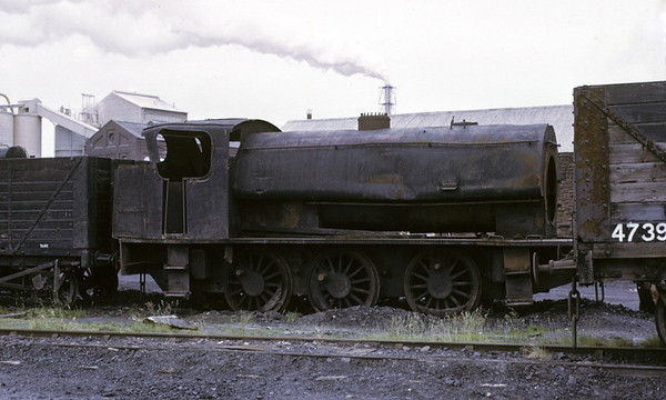 Charles, Ladysmith coal washery, Whitehaven, 9 June 1973.   A very battered Hudswell Clarke 1778 / 1944, subsequently scrapped.  It had previously worked on the NCB's Walkden Rly, where it had been the first of several locos to be fitted with a Giesl ejector in 1961 to reduce black smoke.  Photo by Les Tindall.