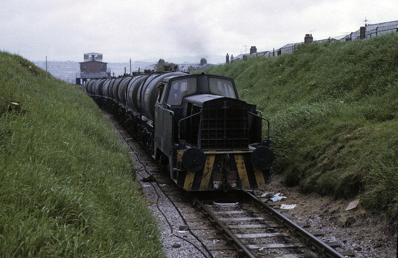 Albright & Wilson Sentinel, Whitehaven, 9 June 1973.  The diesel is bringing wagons to the chemical works from the top of the Corkickle Brake, whose control building can be seen in the distance.  A & W had two Sentinel diesel-hydraulicss, works nos  10085 & 10086.  Both were scrapped in 1986.  Photo by Les Tindall.