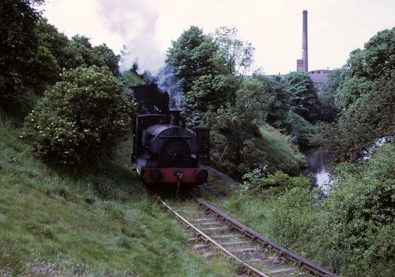 May, Yates Duxbury paper mill, Heap Bridge, Heywood, 15 June 1973.  The Peckett 0-4-0ST comes out of the mill.  At the time of this photo by Les Tindall the two Pecketts were supposed to be sold for scrap and the Barclay used.