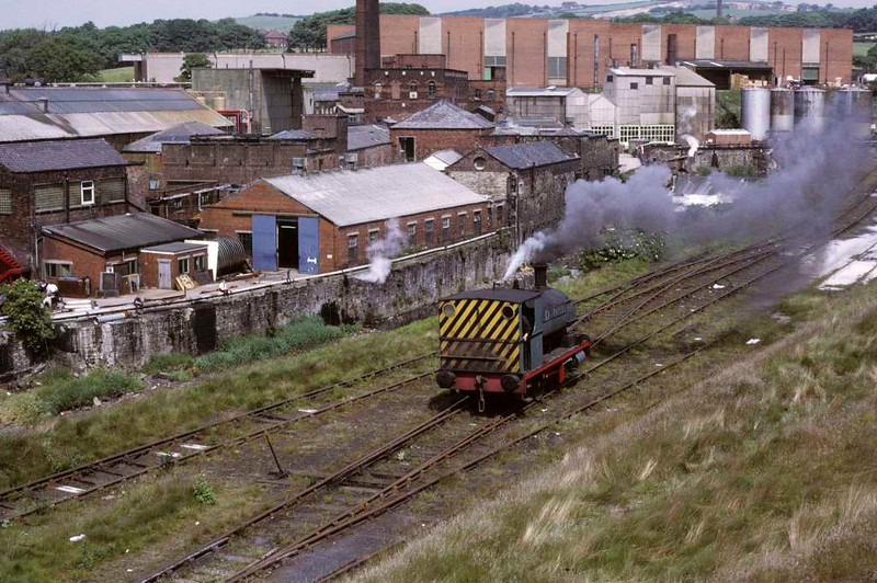 May, Yates Duxbury paper mill, Heap Bridge, Heywood, 15 June 1973.  The Peckett 0-4-0ST heads up to the BR interchange sidings.  Photo by Les Tindall.