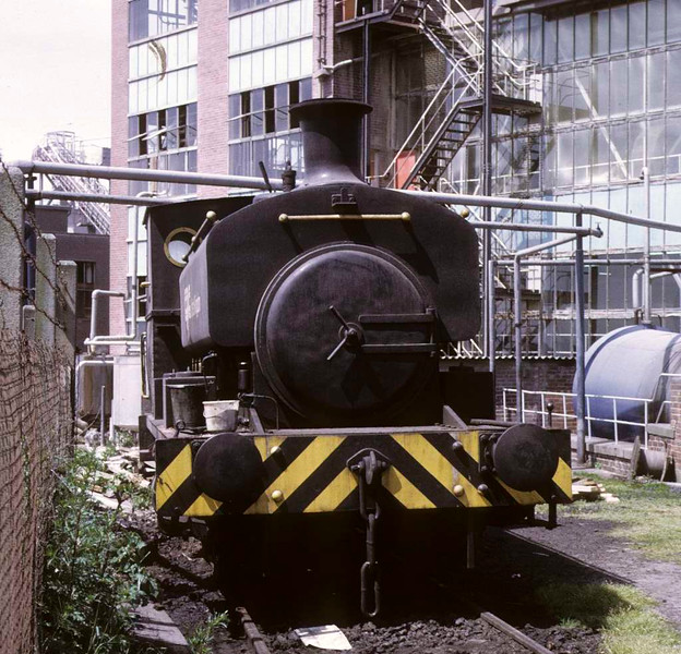 Barclay 0-4-0ST (1964, built in 1929), CPC (UK) Ltd, Trafford Park, 15 June 1973.   In light steam at this cornflower mill.  The company name can just be seen on the side of the tank.  In 2016 the loco was at the Lincolnshire Wolds Railway.  Photo by Les Tindall.