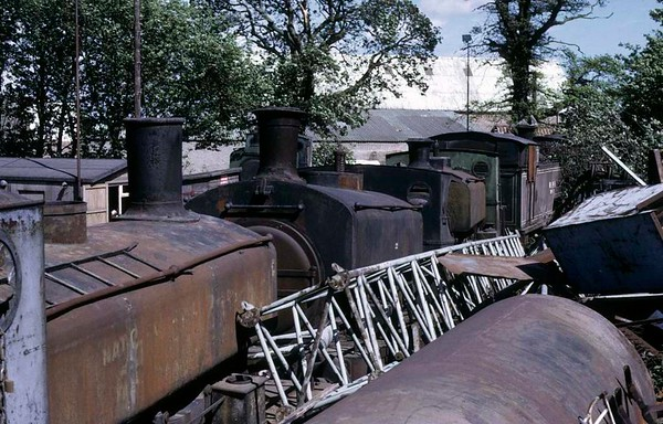 National Coal Board Nos 61 (left), 22, 53 & WPR 17, Thomas Muir's scrapyard, Thornton, 14 June 1973.  No 61 is Grant Ritchie 0-4-0ST 272 / 1894, and in 2016 was at the Ribble Steam Railway.  No 22 is Barclay 0-4-0ST 1069 / 1906.  No 53 is Barclay 0-4-0ST 1807 / 1923.  Nos 22 & 53 were both still at Muir's scrapyard in 2015.  Photo by Les Tindall.