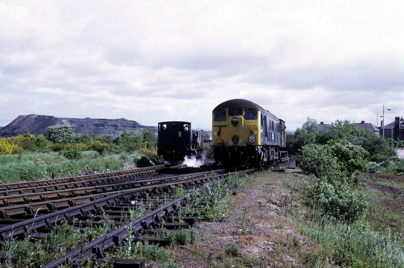 National Coal Board Scottish North Area 0-4-0ST No 21 & 5069 (24069), Kinneil colliery, June 1973.  The BR/Sulzer Type 2 leaves the colliery.  Photo by Les Tindall.