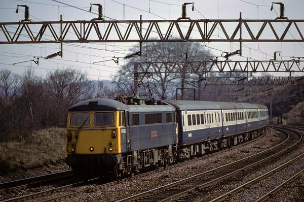 87023 Highland Chieftain, approaching Stafford, April 1980.  The 1245 Euston - Glasgow.  The loco was exported to Bulgaria in 2012. Photo by Les Tindall.
