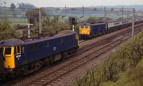 86011 & 87xxx, Whitehouse Junction, June 1979.   86011 was stationary on an up freight.  Photo by Les Tindall.