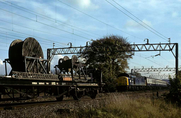 40027, near Whitehouse Junction, 14 October 1979.   The 1205 Birmingham - Glasgow passes the electrification train headed by 25053. 40027 was scrapped in 1984. Photo by Les Tindall.
