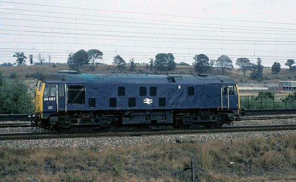 24087, near Whitehouse Junction, 31 August 1976.  One of the last surviving 'Rats' runs south on the up slow line shortly before the class was withdrawn.  The loco was scrapped in 1978. Photo by Les Tindall.