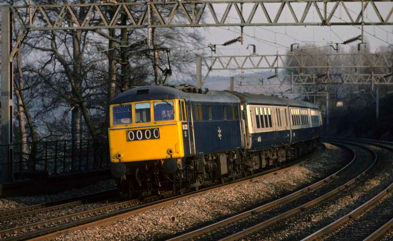 86220, near Stafford, 6 March 1976.  The 1500 Euston - Carlisle.  The loco was scrapped in 2003.  Photo by Les Tindall.