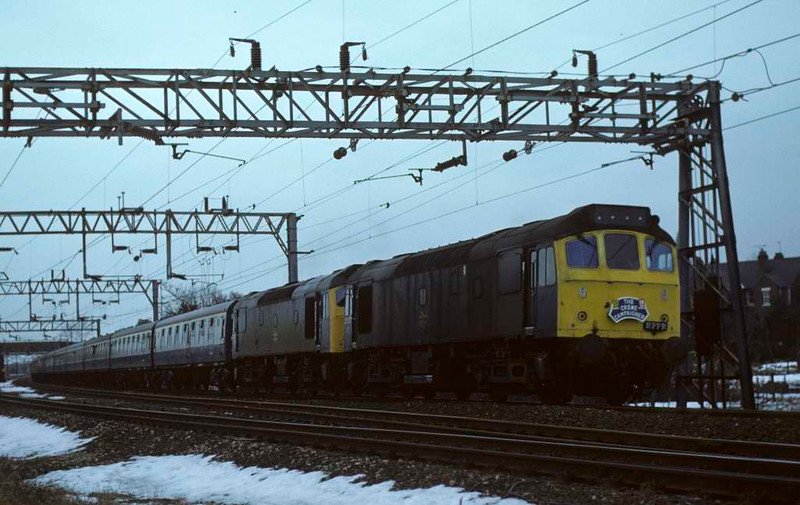 25277 & 25282, 1Z69. Stafford, 11 February 1979 1.  The Crewe Campaigner slowly approaches the station from Wolverhampton after a signal stop.   Organised by Railway Pictorial Publications Railtours, it ran from Paddington via Oxford to Crewe to visit the works.  It was hauled by four pairs of diesels.  The Rats seen here worked it from Birmingham New Street to Crewe.  Demand was such that a relief tour was run, using the same locos.  Photo by Les Tindall.