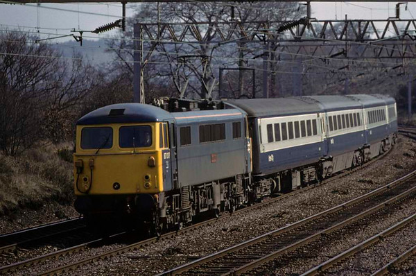 87017 Iron Duke, approaching Stafford, April 1980. The 1255 Euston - Manchester. The loco was exported to Bulgaria in 2012. Photo by Les Tindall.