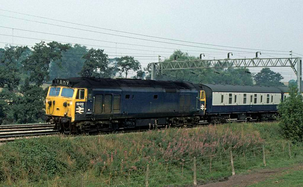 50012, near Norton Bridge, Sun 7 September 1975.  Heading south with ecs.  The loco was scrapped in 1989.  Photo by Les Tindall.