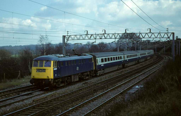 81007, approaching Stafford, April 1980.  Heading an unidentified service train formed of Mark 3 coaches the day after the previous shot.  Photo by Les Tindall.