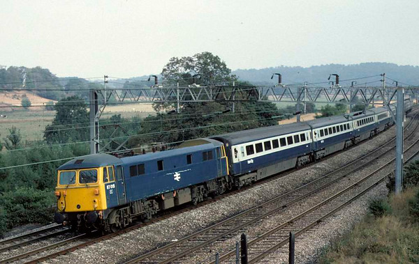 87015, near Whitehouse Junction, 31 August 1976.  The 1345 Euston - Glasgow, formed of new Mark 3F stock.  The loco was scrapped in 2005.  Photo by Les Tindall.