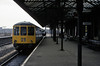 Class 104 DMU, Stalybridge, 27 March 1976     The two car DMU stands at platform 3 with a service from Stockport.  Photo by Les Tindall.
