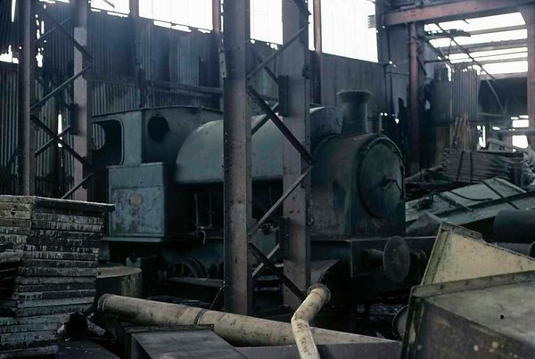 [Etruria gasworks loco], Brookfield Foundry, Stoke-on-Trent, September 1975 1.  Kerr Stuart 0-4-0ST (4388 / 1926).  At the time of this photo it had been stored out of use for a number of years in this derelict shed on part of the old Kerr Stuart California Works site.  The loco is now preserved on the Foxfield Railway.