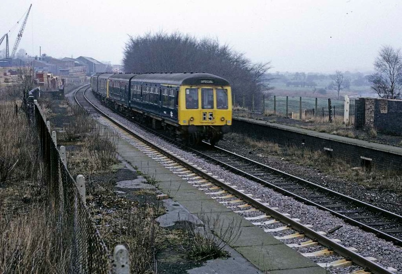 Cannock station, Sat 23 February 1974.  Three two-car DMUs pass the former LNWR station, which had closed in January 1965.  It reopened in April 1989.  Photo by Les Tindall.