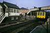 Cradley station, Sat 30 March 1974.  A Birmingham - Kidderminster train arrives at the down platform.  At the time of this photo the up platform was east of the level crossing,  It was moved to the western side in 1984 when the station was rebuilt.  The signal box used to be named Cradley Heath and Cradley East.  The former GWR station has never closed.  Photo by Les Tindall.
