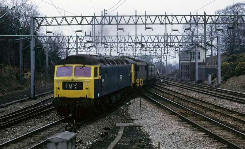1848 (47198) & 86215, Rugeley North Junction, Sat 23 February 1974.  The diverted 1210 Manchester - Euston leaves the WCML and heads towards Cannock.  Photo by Les Tindall.