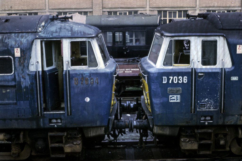 D7034 & D7036 awaiting scrapping, Old Oak Common, 18 June 1972.  Photo by Les Tindall.  (The pale blue stripes on the white cab window surrounds are caused by deterioration of the Agfachrome slide.)
