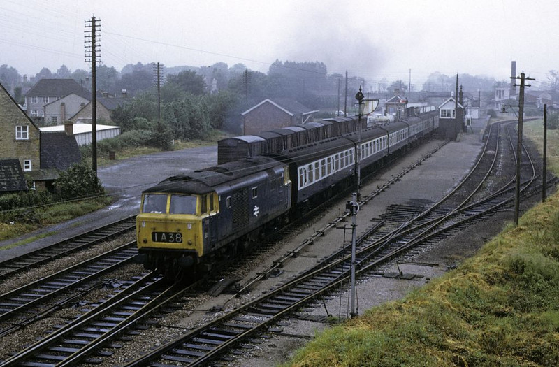 7087, Moreton-in-the-Marsh, 26 July 1972    Photo by Les Tindall.  Leaving with the 1100 Worcester - Paddington.  7087 was withdrawn in October 1972.