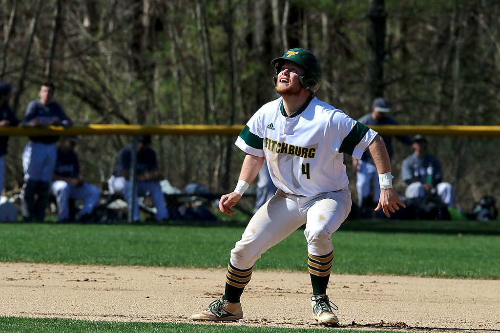 . Lesley University Baseball played Fitchburg State University on May 1, 2018. FSU\'s Andrew Mooney wahtes a teamates hit as he tries to decide if he should take off to third as he lead off second during action in the game. SENTINEL & ENTERPRISE/JOHN LOVE