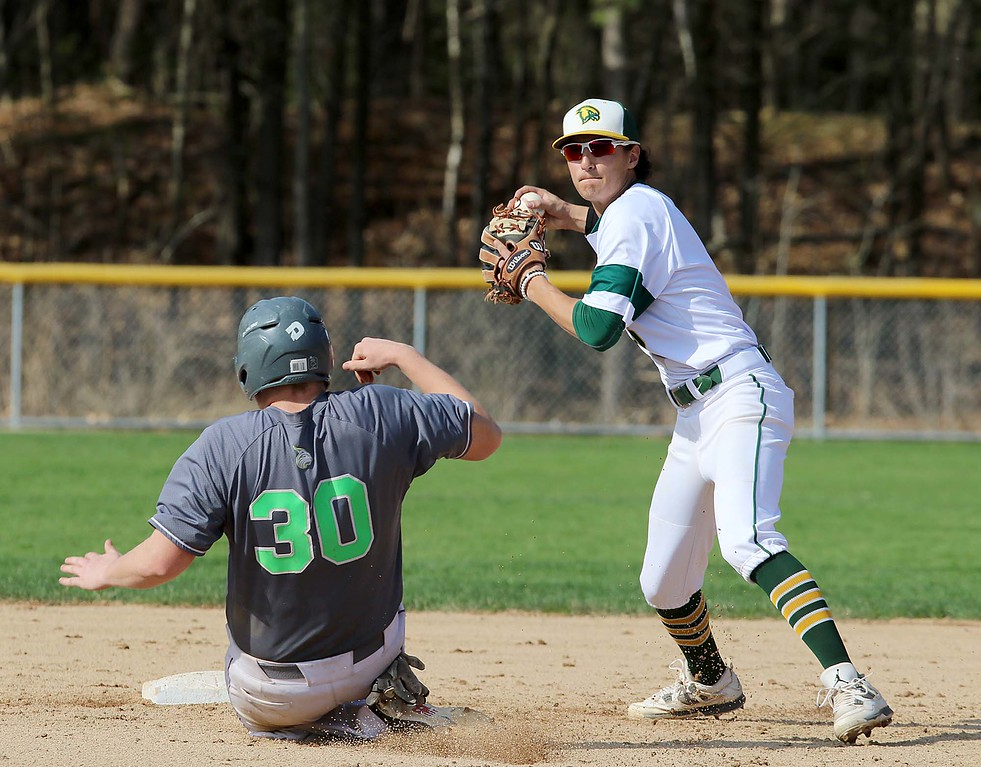 . Lesley University Baseball played Fitchburg State University on May 1, 2018. FSU\'s Brandon Lefebvre gets readt to throw to first after getting out LU\'s Rya Pupphret. SENTINEL & ENTERPRISE/JOHN LOVE