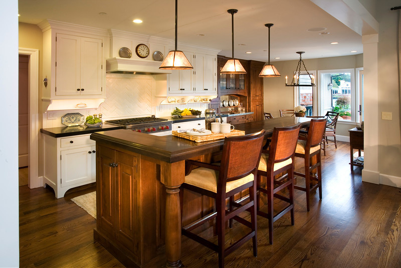 Sandra Bird again. A more modern looking kitchen. But since this is a course about lighting, I must point out that the only way to bring out the color and texture of dark wood is by lighting it with spotlights placed near the camera to avoid reflections. These are highlights, lighting relatively small areas and don't destroy the effect of the window lighting at the far end of the room.