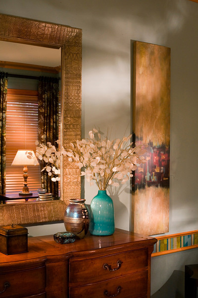 The sparkly silver dollars in the vase and modern art are enhanced by the pattern of light I projected into the room.