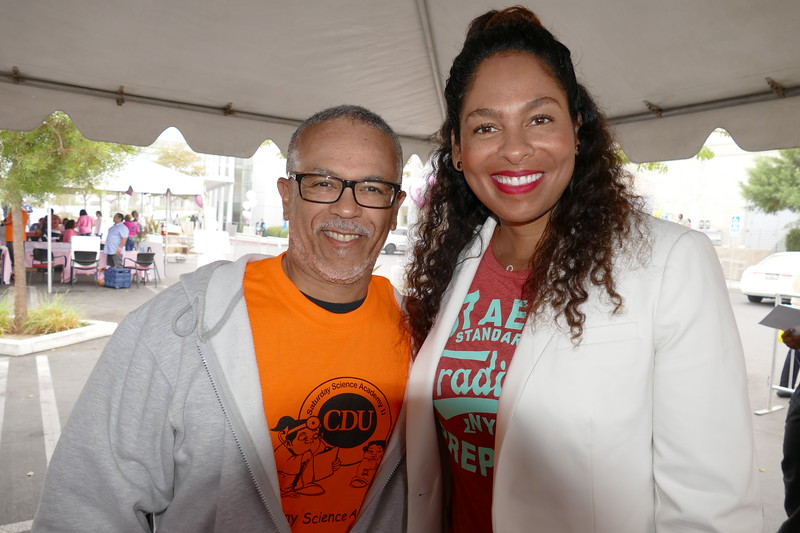 CDU President David M. Carlisle, MD, PhD welcomes KJLH's morning personality Adai Lamar to the Let's Move event last Saturday.