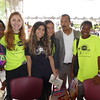 Dr. Ellerby Washington poses with student volunteers at the Let's Move event at CDU