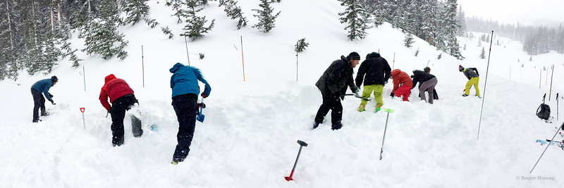 The crew collectively digging a huge pit to study the snow pack at Hidden Valley.