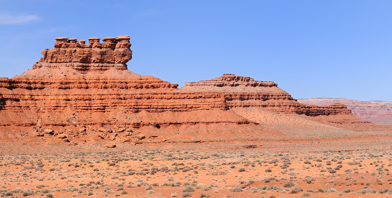 "This is the first of a series of images of various rock structures in the ""Valley of the Gods"". As is common in this part of the west, interesting rock formations are given fanciful names. The formation in the left center here is known as ""Seven Sailors,"" named for what looks like sailor hats on top of seven spires (due to camera angles, one is not visible). This is located close to the east end of the Valley of the Gods 17-mile road, just off Route 163. March 5, 2012. Nikon D300 and Nikkor 24-70 f/2.8 lens at 44mm DX or 66mm FX."