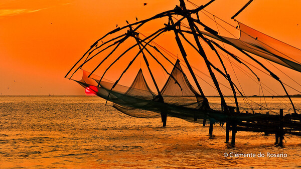 Silhouetted Chinese Fishing Nets at sunset in Fort Cochin, Kerala, India File Ref: Kerala-2006 096R 1519
