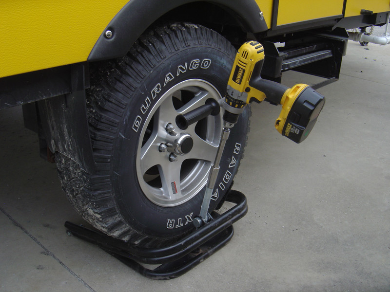 """The leveler in a raised position. I use a 18 Volt DeWalt drill to raise and lower the BAL leveler. The attachements include: 1. 1/4"""" hex to 1/2"""" square adapter 2. 1/2"""" extension rod 3. 3/4"""" socket"""