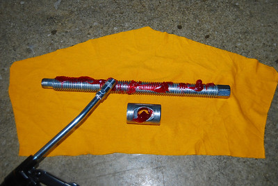 With my grease gun, I applied dabs of grease to both the screw and the nut.
