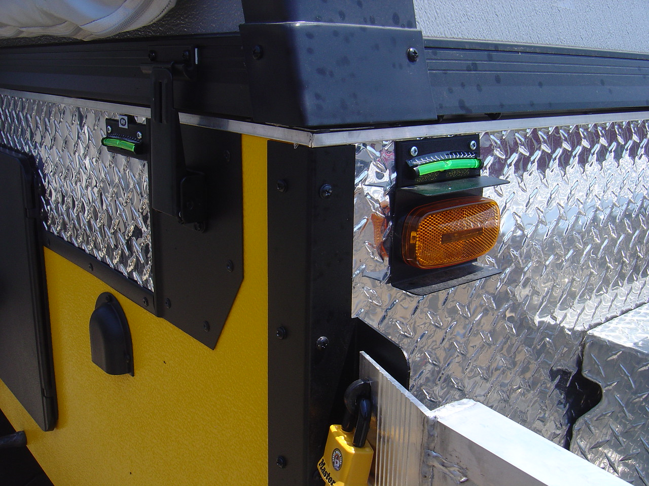 I've added levels to both corners sides (front and side) of the front of the PUP.  This allows me to quickly see what adjustmenets I need to make to level the PUP.  Note - I have another pair of levels mounted on the other side of the trailer.