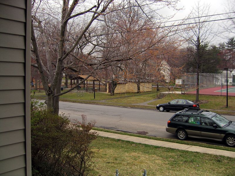 Another shot from the same place as the last picture.  As you can see, the park across the street has a playground for kids, tennis courts, and a basketball court.  It also has a small baseball diamond, but that isn't visible from our house as it's further out.